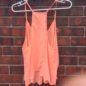 Coral open back scalloped blouse.